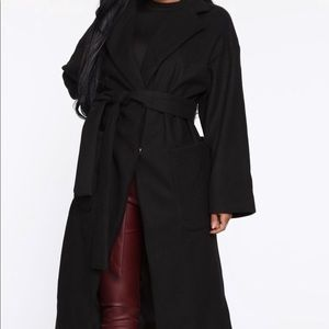 A black trench coat. brand new and never worn.